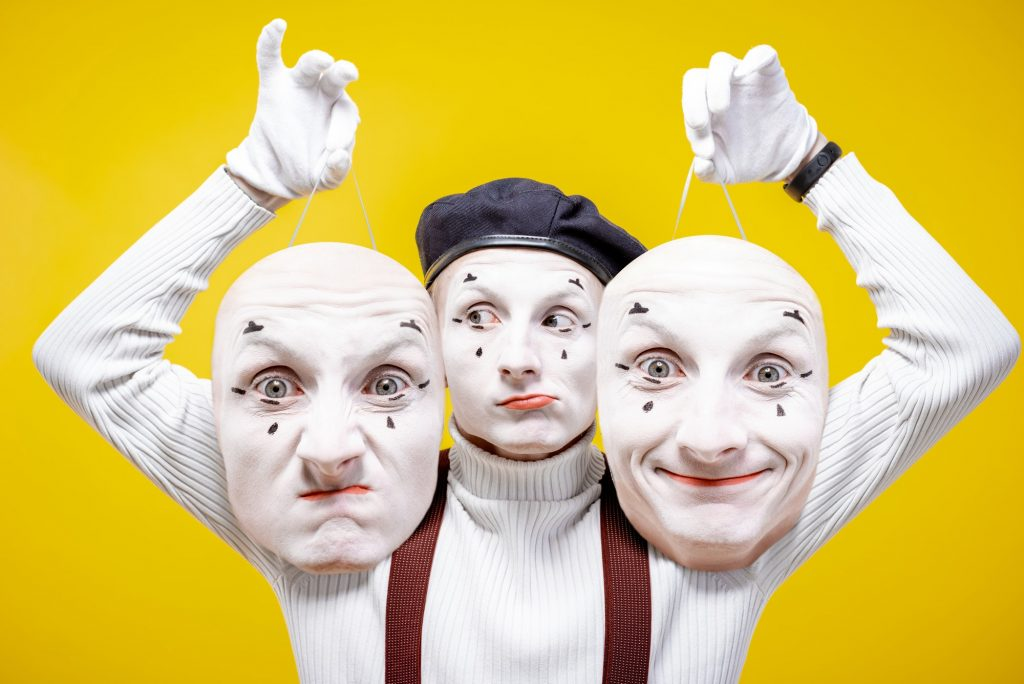 Pantomime with different facial masks