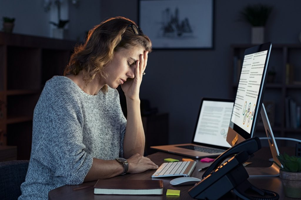 Stressed woman working over time at night