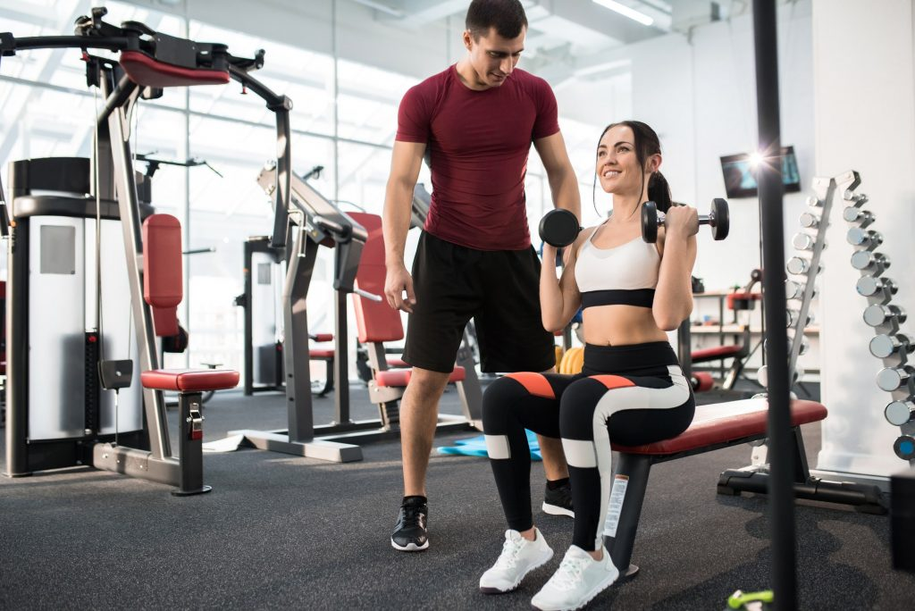 Woman Training with Fitness Coach